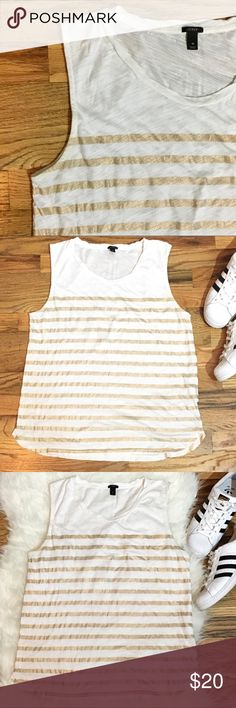 J. Crew white tank w/ metallic gold print stripes J. Crew white tank w/ metallic gold print stripes, EUC. very faint not noticeable spots on back (pictured on close up pic,  can barely see it). J. Crew Tops Tank Tops
