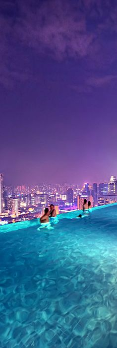 Pool with a view!  Marina Bay Sands Resort - Singapore (Malaysia).  ASPEN CREEK TRAVEL - karen@aspencreektravel.com