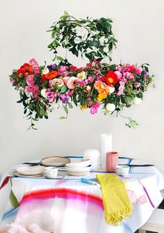 We created this gorgeous hanging flower chandelier from scratch in an afternoon for a statement centrepiece that looks incredible – and smells heavenly.