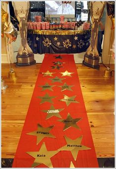 Michelle has tons of party theme boards.......This pin is from a hollywood party board of hers......click on her name to visit all her boards.      Decorate the floor too. Guests names on gold stars on top of red carpet--thesucculentwife.com: