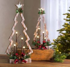 Our set of two Tabletop Lighted Wooden Christmas Trees is a new take on a traditional holiday icon. These abstract tabletop Christmas trees are crafted from … Wooden Christmas Tree Decorations, Tabletop Christmas Tree, Unique Christmas Trees, Wooden Christmas Trees, Rustic Christmas, Holiday Decor, Primitive Christmas, Simple Christmas, Christmas Projects