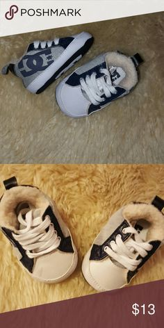 DC crib shoes. Baby crib shoes. Fuzzy lining to keep little feet warm. Small mark on right shoe shown in second picture. DC Shoes Sneakers