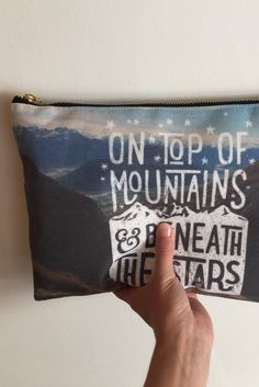 The mountains are calling... and we must go and get one of these gorgeous pouches to take on our next adventure! Love these typographic designs by Cabin Supply Co on Redbubble. Sooth your inner wanderlust with a tee, bag, or mug from this artist.