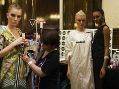 Models with strong, sleek hair styles, ready to parade the catwalk