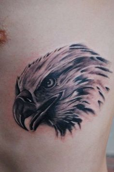 Simple Grey Ink Eagle Head Tattoo