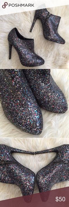 Topshop multicolored glitter bootie Gorgeous and fun topshop booties. Multicolored glitter. 5 inch heel and side zip  (size 39) slight bit of wear on sole but in great condition. Topshop Shoes Ankle Boots & Booties