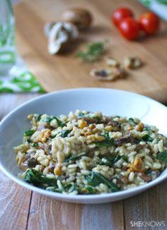 Vegan spinach and mushroom risotto with toasted walnuts - use nutritional yeast instead of Parmesan