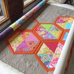 I can't decide what I love more on this quilt, the pattern or the…