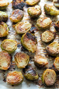 """Even veggie haters love these crunchy, flavorful brussels sprouts! When I was 19, I spent some time """"living"""" in Europe. I was young, working a crappy job, dating an even crappier dude, and figured ditching town was my chance to shake off some stagnant strings and explore the world! So like any sane minded young..."""