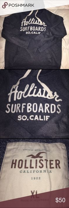 Navy Blue Hollister Hoody It's an all navy blue Hollister Surfboard Hoody with white draw strings on the hood and white Hollister Surfboard Logo . The size says XL but it fits more like a Large Hollister Sweaters