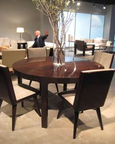 The new Calvin Klein  collection is so tasteful, classic, modern and, uh, totally Calvin. This round walnut dining table has lovely legs and an elegant shape.   - ELLEDecor.com