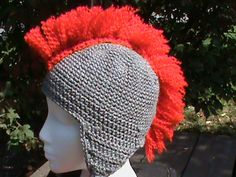 70141b9d980 Knitted hat in the shape of a Roman Spartan helmet. Awesome.