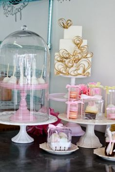 Like how the small cake stand is on top of a cake plate and under a really tall glass dome