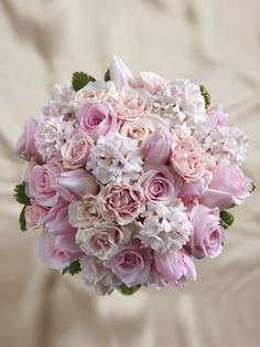 This pink wedding bouquet is a display of blushing sweetness full of feminine charm. Pink roses, tulips, spray roses and sweetly scented hyacinth are brought together to form a bouquet that is both eye-catching and elegant tied together with a pink satin ribbon for a complete look.