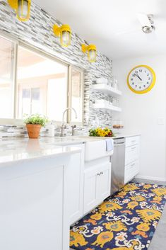 This white Urban Farmhouse Kitchen is so bright -- love the pops of yellow!