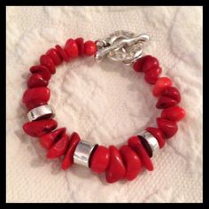 ROBERT LEE MORRIS Red Coral and Silver bracelet ❤️ROBERT LEE MORRIS❤️Red Coral and Sterling Silver Bracelet. Approximately 7 1/2 inches long with a toggle closure. RLM is stamped on the closure, as seen in pict 2. In excellent condition worn a few times. Reasonable offers welcome.  RLM Jewelry Bracelets