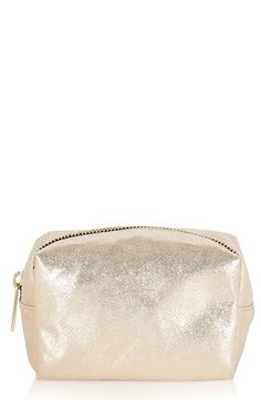 Crushing on this mini metallic makeup bag. Not only is it just, darling, it's also the perfect size for on the go beauty necessities.
