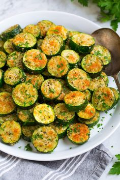 Easy Baked Zucchini - sliced, fresh summer zucchini is tossed with olive oil, garlic, and herbs then sprinkled with parmesan cheese and oven baked. It's the best way to make roasted zucchini!