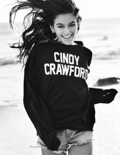 Kaia Gerber models the Cindy Crawford sweatshirt from Reformation