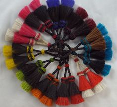 Loads of color in Knot-a-Tails endless array of horse hair tassels.  http://knot-a-tail.com/node/115  The tassel is from http://knot-a-tail.com/catalog/16  #horsehair tassels