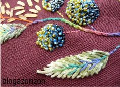 Chenille leaves, berries sewn on a round muslin and then gathered stuffed and qppliqued