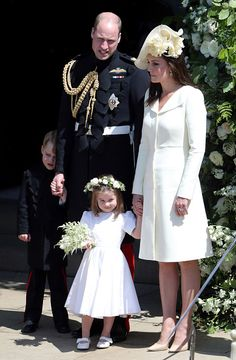 Britain's Prince William, Duke of Cambridge and Britain's Catherine, Duchess of Cambridge leave with their children Prince George and Princess Charlotte after attending the wedding ceremony of Britain's Prince Harry, Duke of Sussex and US actress Meghan Markle at St George's Chapel, Windsor Castle, in Windsor, on May 19, 2018.