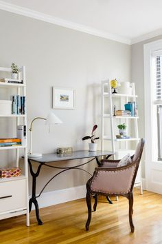 More than any other room, the office is a perfect mix of Victoria's love for industrial, vintage style with feminine touches. The curves of the metal desk accentuate the lines of the French-style upholstered chair.