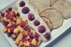 Banana pancakes with nectarine, raspberries and cashew cream.