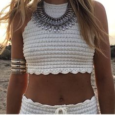 Crochet Halter Crop Top Crochet halter cropped tank top with strappy open back. Unlined  Imported. Color is natural not white. Nasty Gal Tops Crop Tops