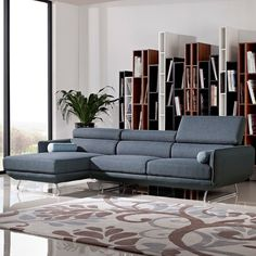 """Divani Casa Pierce Modern Blue Fabric Sectional Sofa Nice, clean lines! And great slate-blue colour.  """"The Divani Casa Pierce Modern Blue Fabric Sectional Sofa has a cozy appeal, featuring wide adjustable headrests and a left facing chaise. The genteel blue-grey fabric upholstery is highlighted with light blue piping. This modern sectional sofa includes 2 log-shaped pillows and stands on sturdy stainless steel legs."""""""