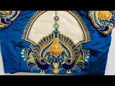 This video shows you how to embroider a grand bridal blouse designs with Lakshmi pendant at the back and for sleeve. It includes fixing of the pendant and ba. Wedding Saree Blouse Designs, Pattu Saree Blouse Designs, Silk Saree Blouse Designs, Fancy Blouse Designs, Saree Blouse Patterns, Aari Embroidery, Embroidery Designs, Maggam Work Designs, Sleeves Designs For Dresses