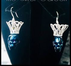 Swarovski Crowned Skull necklace & earring sets! 13mm skull crystals with rondelle crystals sitting inside a filigree silver tone crown. The
