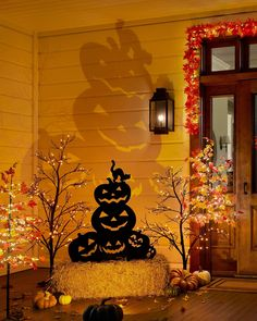 Surprise the neighborhood this Halloween with Jack's friendly grin. Halloween Jack, Halloween Season, Orange Led Lights, Realistic Christmas Trees, Slim Tree, Balsam Hill, Metal Art Projects, Halloween Silhouettes, Wreaths And Garlands