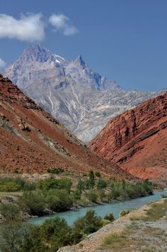 """Palette of mountains, Tajikistan. The Pamir Mountains are a mountain range in Central Asia formed by the junction of the Himalayas with Tian Shan, Karakoram, Kunlun, and Hindu Kush ranges. They are among the world's highest mountains, and since Victorian times, they have been known as the """"Roof of the World."""""""