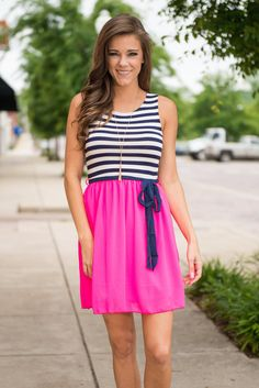 Drift Away Dress, Fuchsia    Don't drift too far away with those daydreams you're havin' right now! We know it's easy to get wrapped up picturing where you'll wear this striped and bright number, but you can bet a dress this eye-catching won't be around long! It's comfy, cute and easy to complete! Just add a great pair of sandals or wedges and you're good to go!