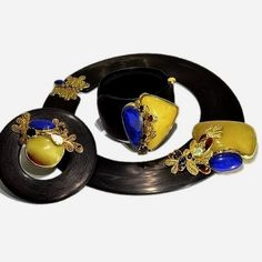 Unique statement collar necklace handcrafted from silver, amber (4.5 cm - 6.5cm), brown, natural opal, iolite, garnet, lapis lazuli, gold plated 24-galvanized. Carbon fiber, hand-molded.SCHJ  www.silverchamber...