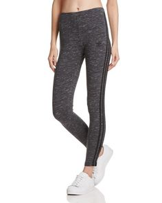 Keep it classic from gym to street in these signature leggings from adidas Originals that feature the label's signature three-stripe motif.   Cotton/elastane   Machine wash   Imported   Fits true to s