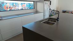 Polished concrete kitchen and island benchtops by Mitchell Bink Concrete Design.  www.mbconcretedesign.com.au