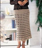 easy scallop skirt -- found at http://web.archive.org/web/20071114053413/http://www.coatsandclark.com/Crafts/Crochet/Projects/Magazines/CTOCT06+Easy+Scalloped+Skirt.htm