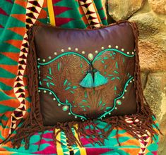 Western art pillow. Love the pop of turquoise.