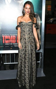 Alicia Vikander in a lace off the shoulder Louis Vuitton dress