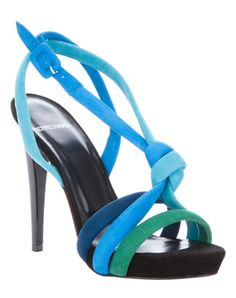 I am not a huge fan of Pierre Hardy when it comes to shoes, but this blue suede sandal featuring tonal suede straps, a knot detail at the front, a buckle side fastening and a black stiletto heel is not bad at all.