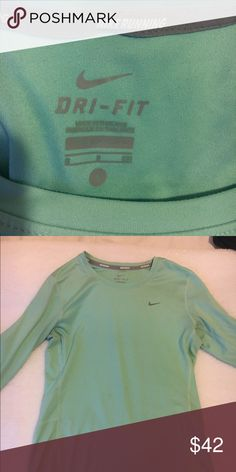 Nike Dry Fit long sleeve In great condition, only worn a couple of times. These photos don't do a very great job at capturing the color- it is a light turquoise. Nike Tops