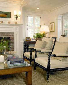 Like fireplace - chairs - windows - beadboard ceiling.
