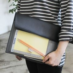 I love, love, love this vintage-style document pouch. Black leather with a see-through pocket.