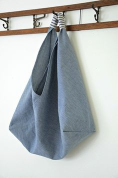 "Easy DIY Oragami Bag. Need one large piece of fabric (17"" x 51"") and a small piece for the handle. Shape is made by folding, only a few seams required."