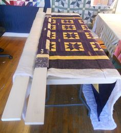 Basting - This seems like it is worth a try.  I don't have room for large quilts to be basted on the floor.  This looks like the system a long arm frame uses basically.