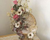 Floral arrangement on miniature rattan chair