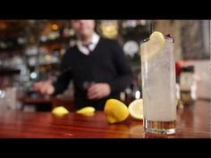 How to make a Tom Collins Cocktail   --I want a liquor cabinet in my house to make classy stuff like this!