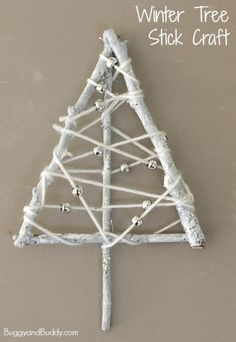 Make a winter tree craft for kids using yarn wrapped sticks!